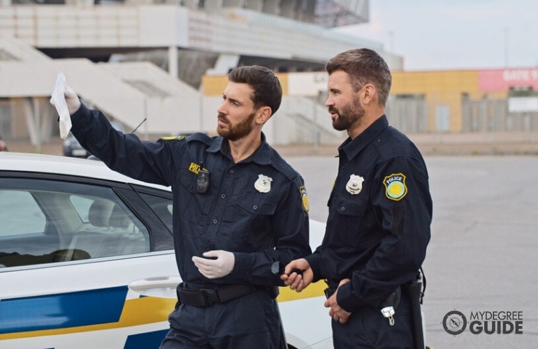 police officers checking evidences on a street accident