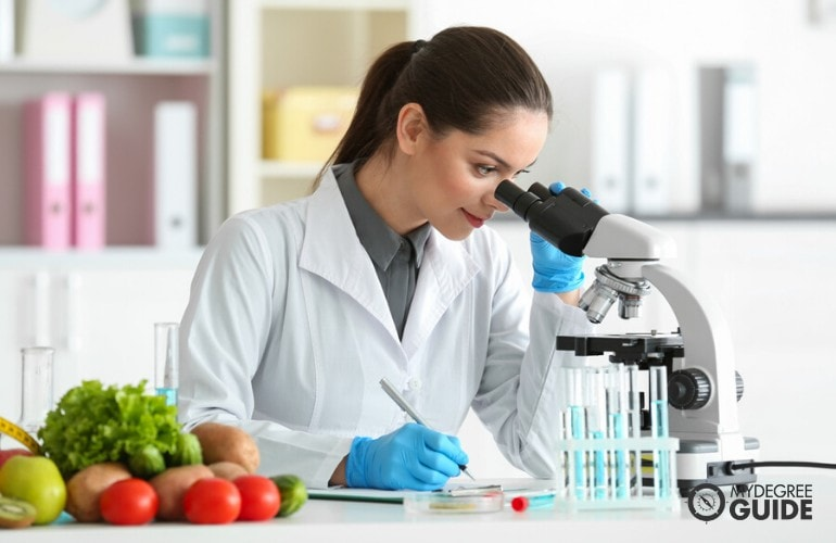 food scientist examining vegetables in a laboratory