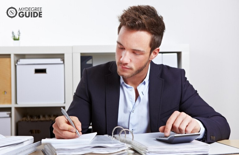 forensic accountant working in his office
