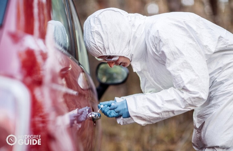 forensics scientist investigating the car and looking for evidences