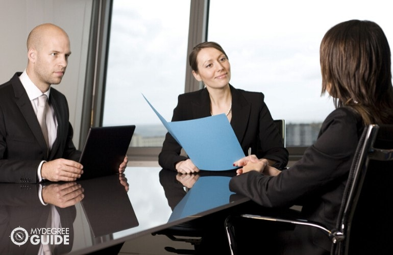 human resource managers interviewing a job applicant