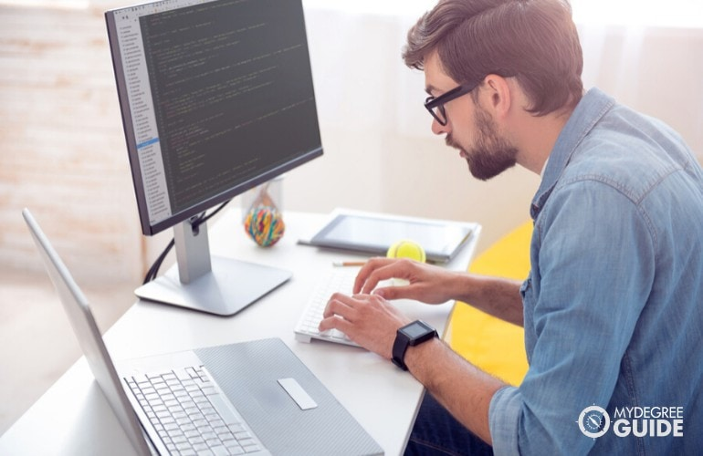 software developer working in his office