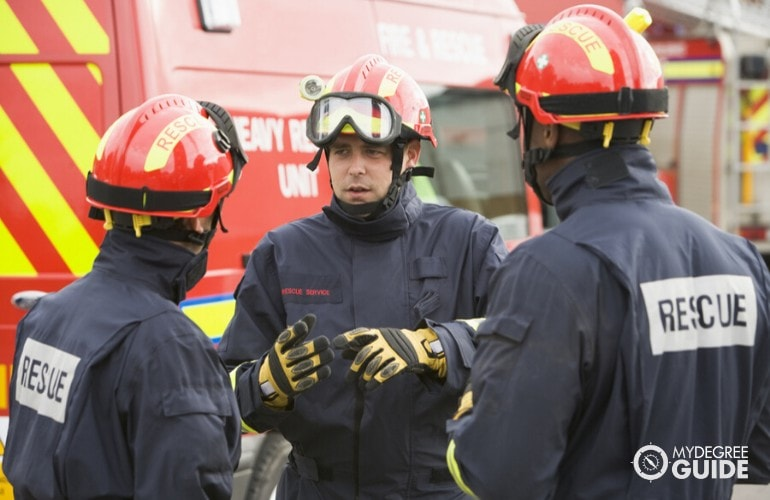 firefighter giving instructions to colleagues