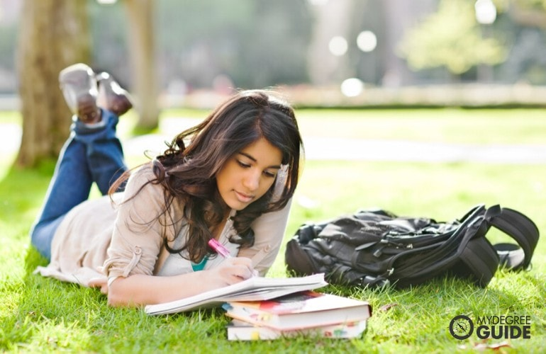 college student studying in university campus grounds