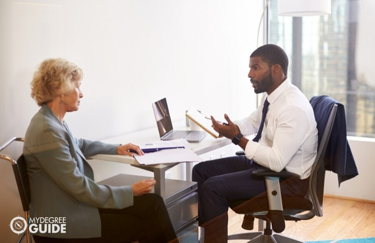 healthcare administrator talking to a patient