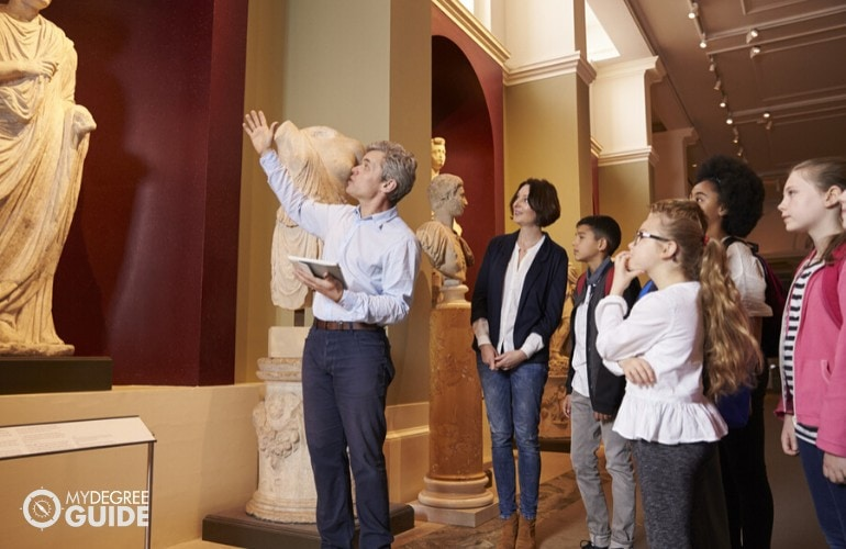 museum tour guide guiding young students