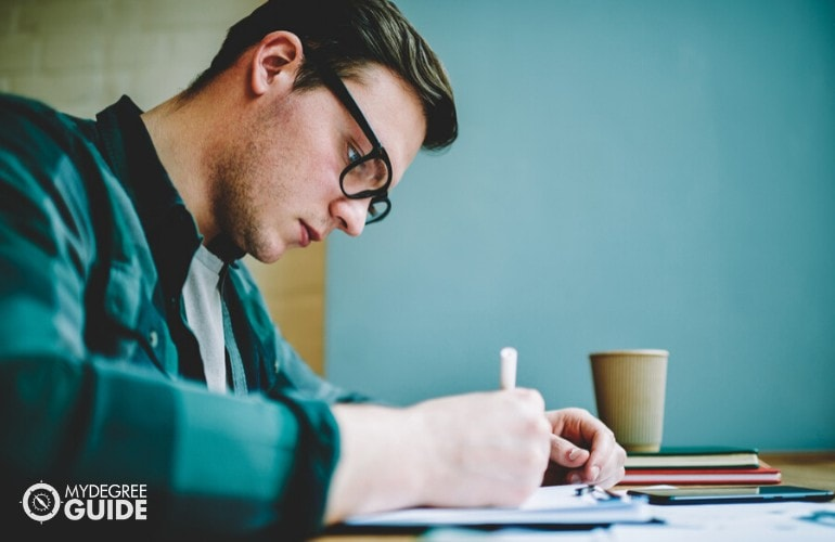 college student studying his notes