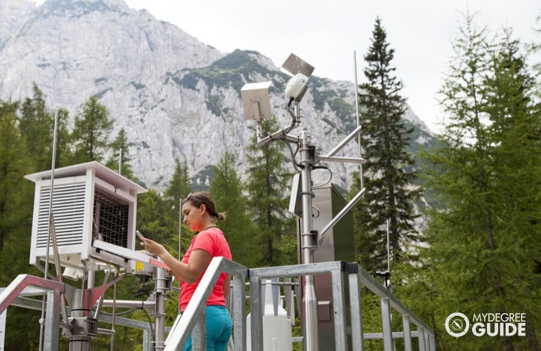 meteorologist working at a facility in a forest