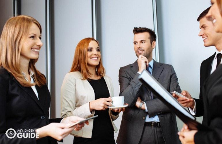 business professionals having a conversation during a seminar