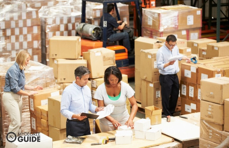 supply chain manager checking the products before shipping
