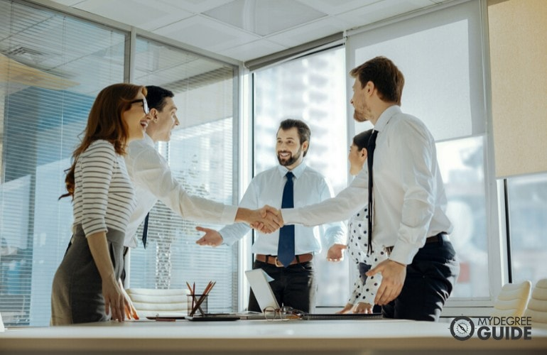 business administrators shaking hands after a meeting