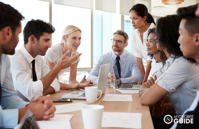 business professionals meeting in conference room