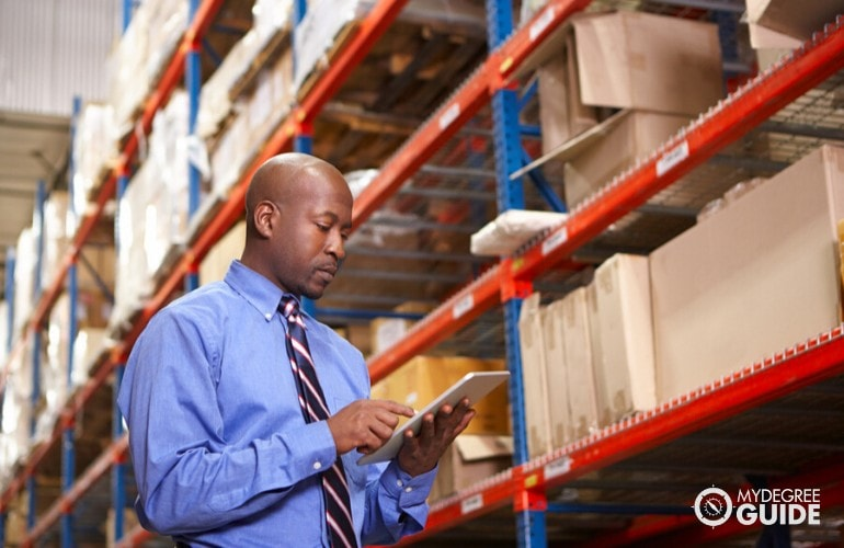 supply chain manager checking warehouse inventory