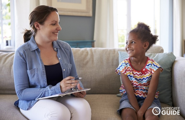 child psychologist interviewing a child in her home