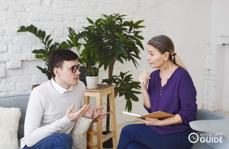 clinical psychologist listening to a patient in her office
