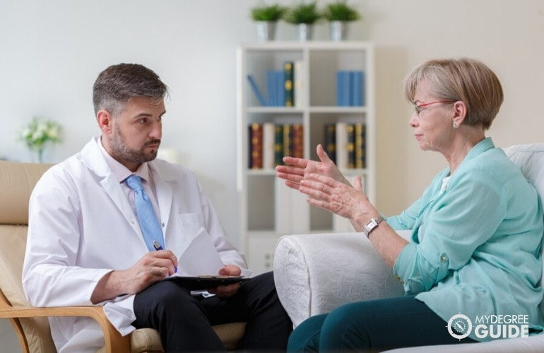 psychologist listening to an elderly patient