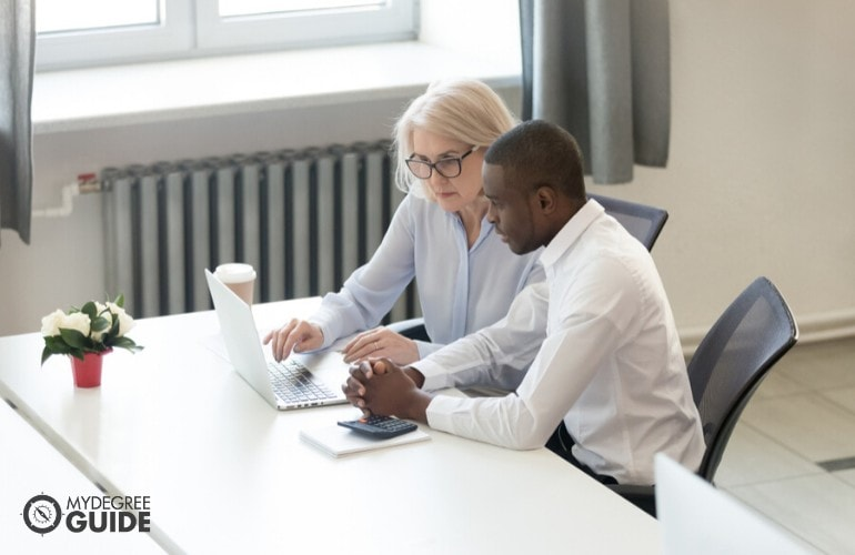 accountants working together in office