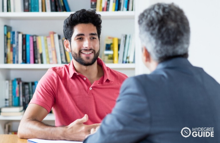 student being interviewed during university admission interview