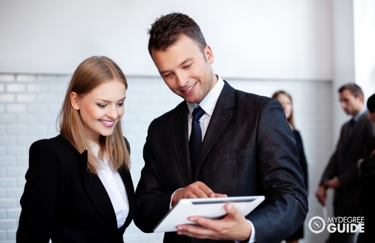 business administrators talking in an office