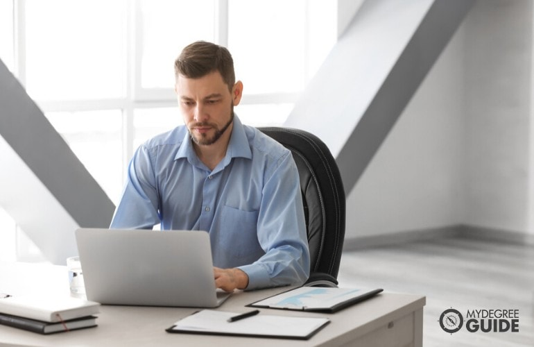 business administrator working on his laptop