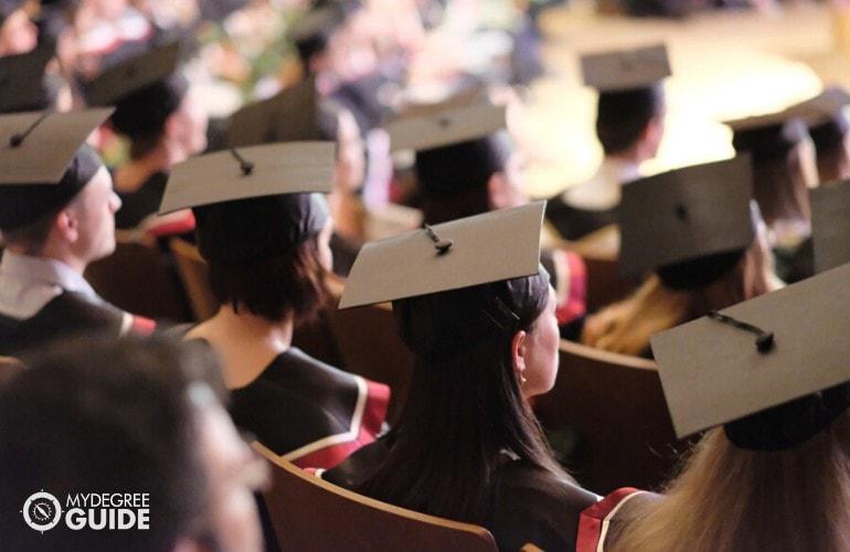 graduating students sitting in university graduation hall