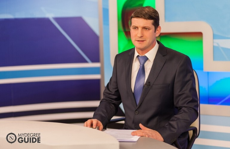 anchorperson in news room