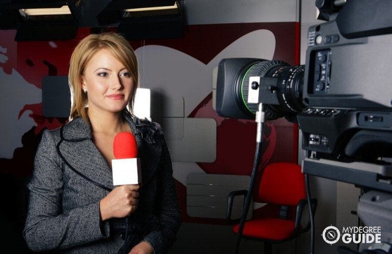 reporter preparing in front of a camera