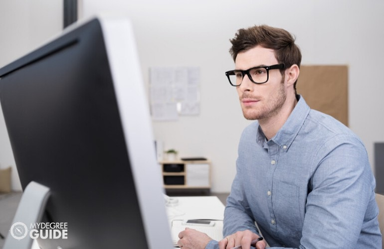 Computer Programmer working in his office