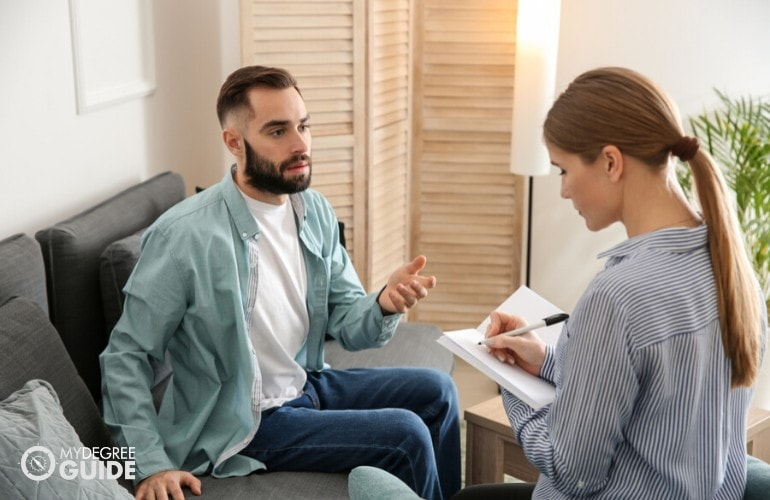 counselor listening to patient during counseling session