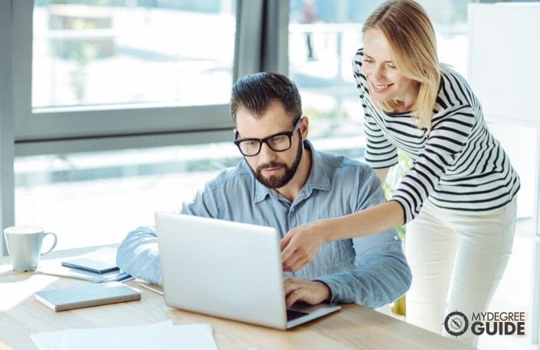 data scientist helping her colleague