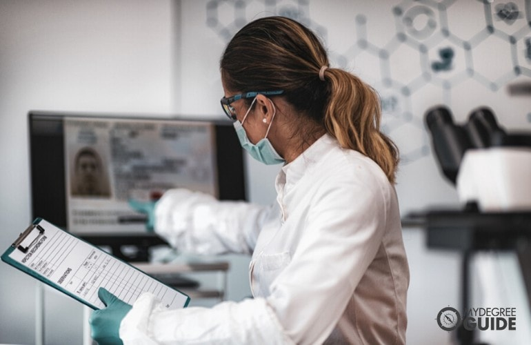 Digital Forensics expert working in a laboratory