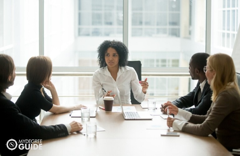human resource manager meeting with company's employees