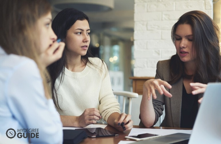 marketing manager sharing ideas with her staff during a meeting