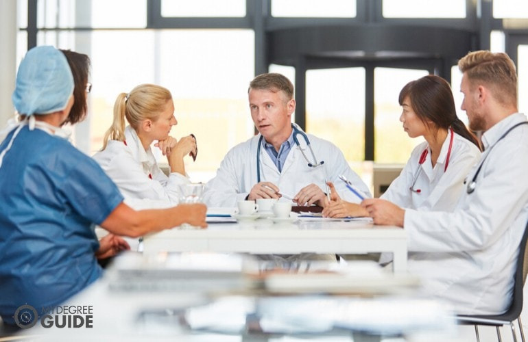 health administrators in a meeting