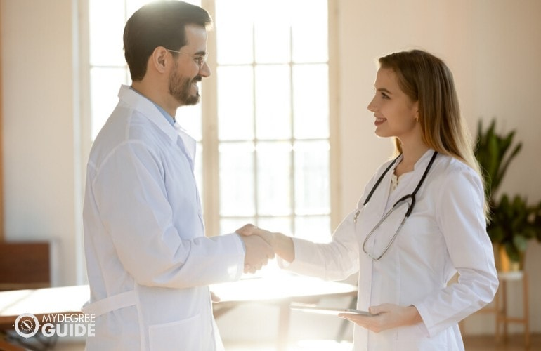 Healthcare Administrators shaking hands after a meeting