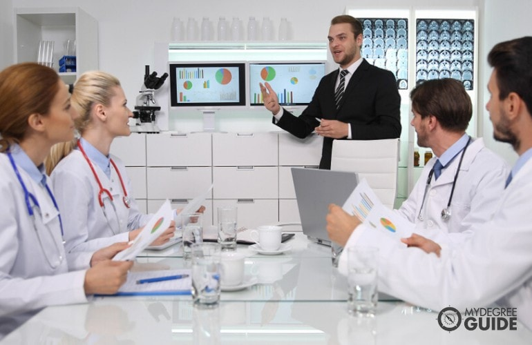 Hospital administrator talking to some doctors