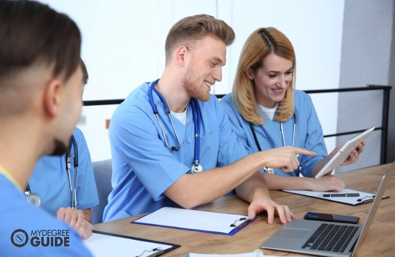 healthcare management students searching for scholarships online