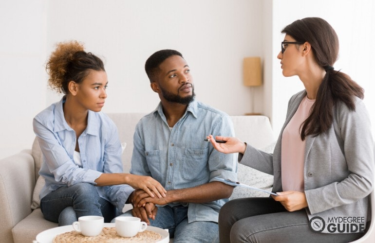 marriage therapist giving advice to a couple