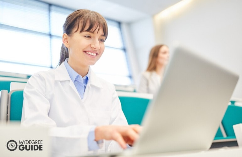 MBA in healthcare Management student studying on her laptop