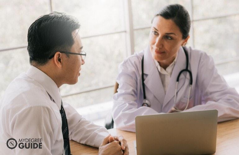 hospital administrator talking to hospital staff