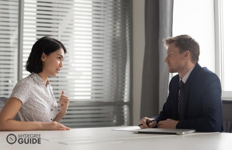 human resource manager talking to a job applicant