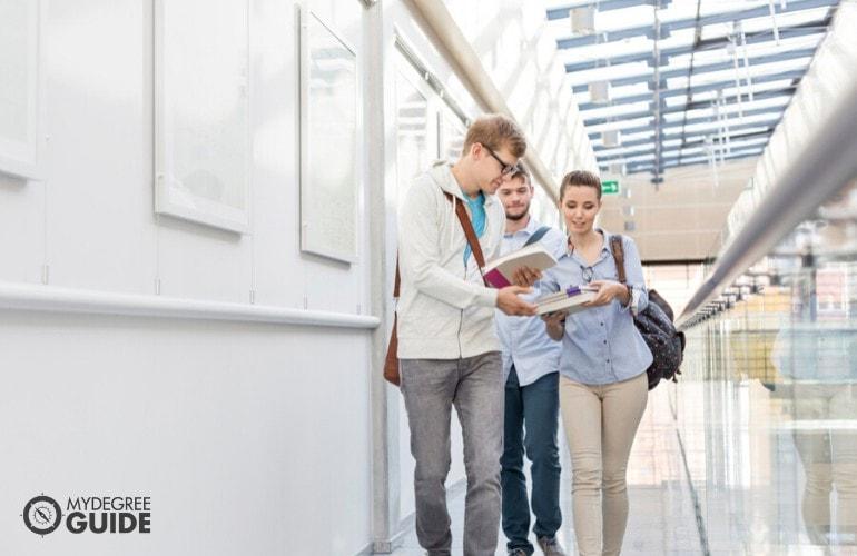 undergraduate students walking in university hallway