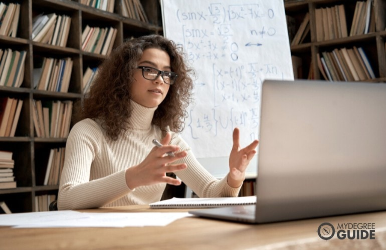 Masters in Teaching degree student studying in library