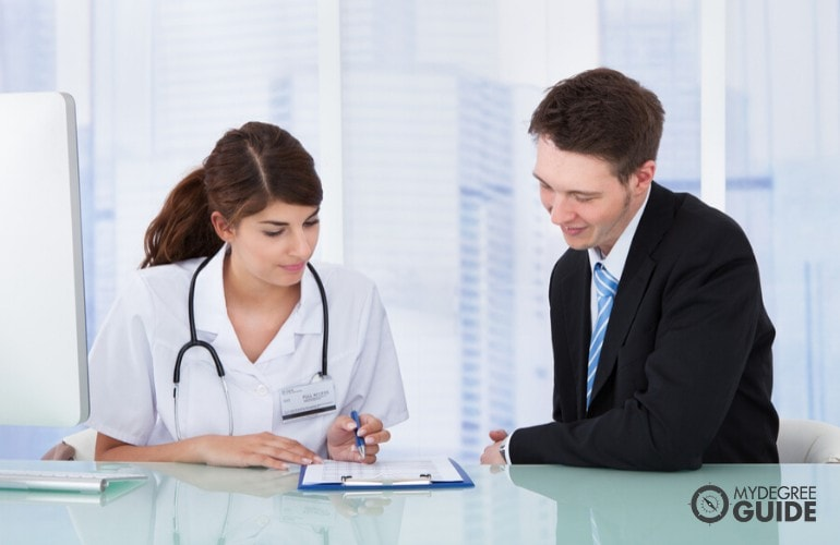 hospital administrator talking to a doctor