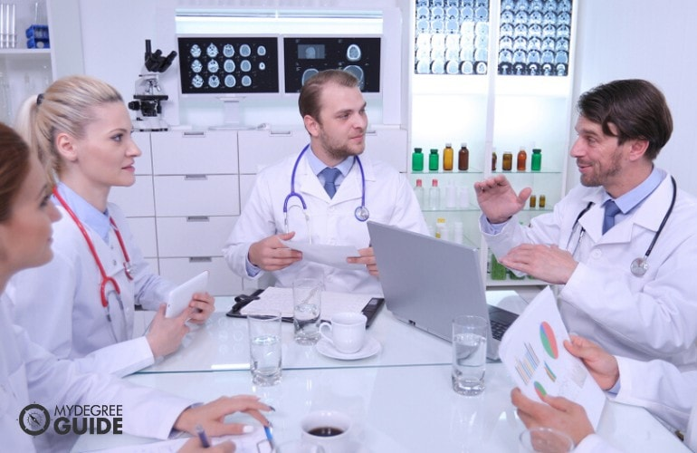 healthcare manager meeting with doctors