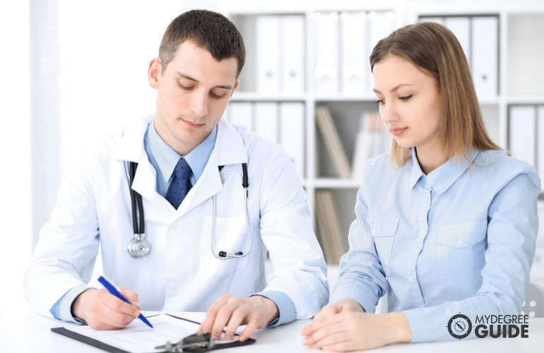 Healthcare administrator working with a doctor