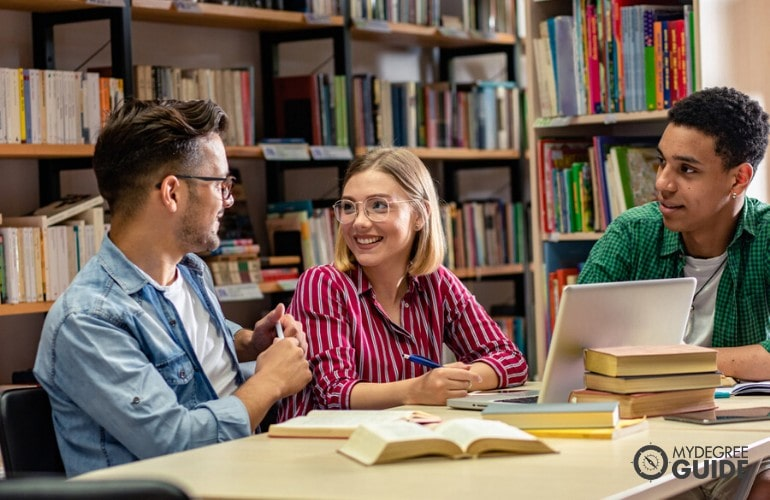 college students studying together in libray