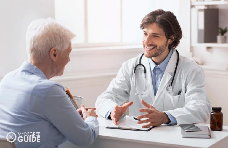 Healthcare Consultant talking to an elderly patient
