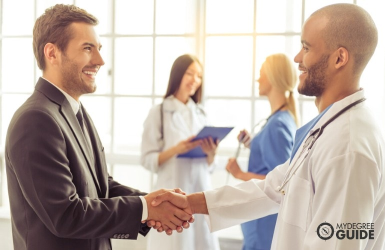 Health Information Management Manager shaking hands of a doctor