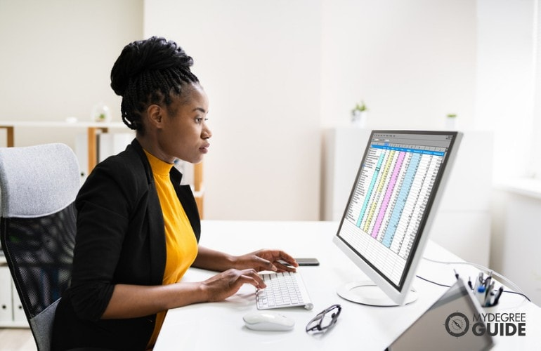 Business Intelligence Analyst working on her computer